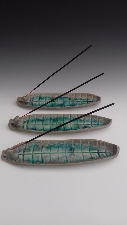 Incense stick burner with glass.